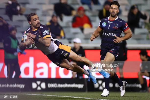Andrew Muirhead of the Brumbies scores during the round one Super Rugby AU match between the Brumbies and the Rebels at GIO Stadium on July 04, 2020...