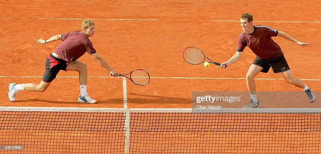 Andrew Murray (R) and Andrew Kennaugh of Great Britain in action during their boys doubles quarter final match against Chekhov and Rudnev of Russia during the eleventh day of the French Open at Roland Garros on June 2, 2005 in Paris, France.
