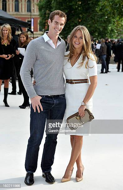 Andrew Murray and Kim Sears arrive at the Burberry Spring Summer 2013 Womenswear Show at Kensington Gardens on September 17 2012 in London England