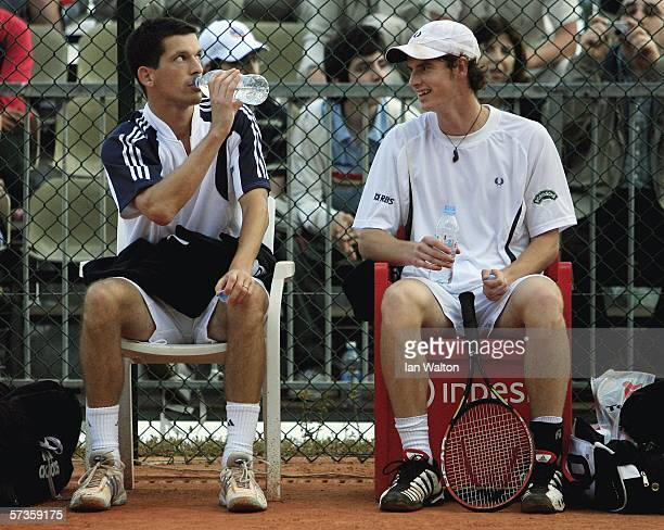 Andrew Murray and Tim Henman take a break during the 1st round doubles match against Tomas Berdych of Czech Republic and Jarkko Nieminen of Finland...