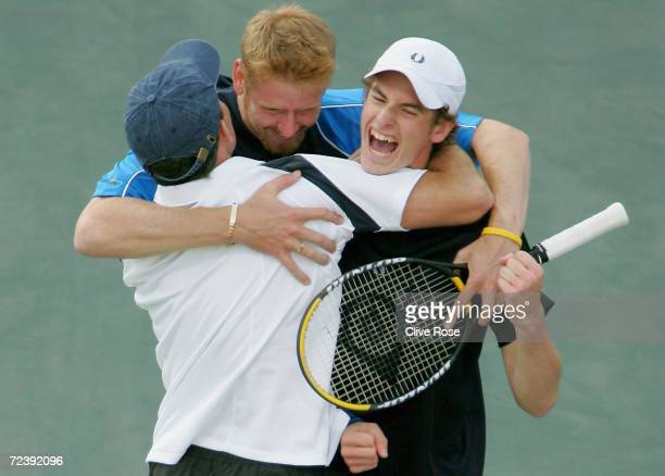 Andrew Murray David Sherwood and coach Jeremy Bates of Great Britain celebrate after they beat Andy Ram and Jonathan Erlich of Israel during the...