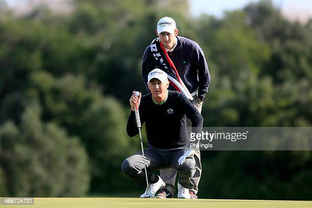 Andrew Murray of England and his son Tom in action during the first round of the European Senior Tour Qualifying School Finals played at Vale da...