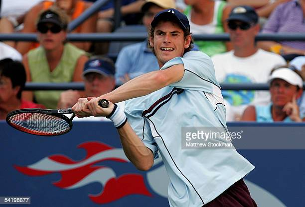 Andrew Murray of Great Britain follows through on a shot to Arnaud Clement of France during the US Open at the USTA National Tennis Center in...