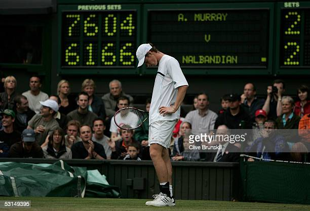 Andrew Murray of Great Britain looks dejected during his match against David Nalbandian of Argentina during the sixth day of the Wimbledon Lawn...