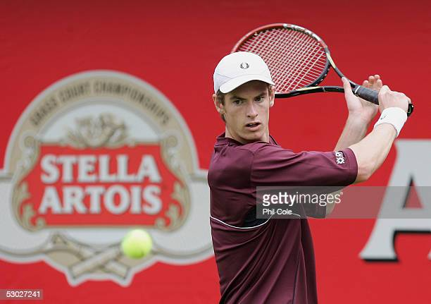 Andrew Murray of Great Britan returns a backhand during his first round match against Santiago Ventura of Spain at the Stella Artois Tennis...