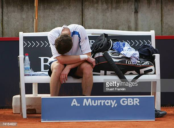 Andrew Murray of Great Britian sits on the bench in pain as he injures his wrist during his match against Filippo Volandri of Italy during day two of...