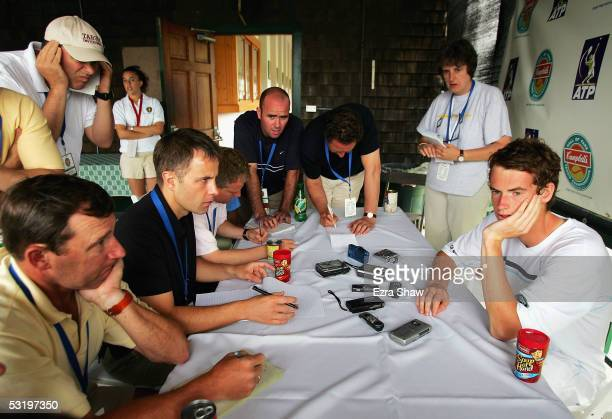 Andrew Murray of Great Britian talks to the media following his match against Gregory Carraz of France on July 5, 2005 in the first round of the...