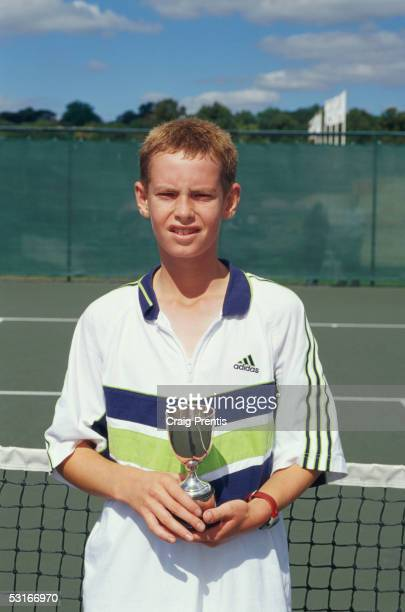 Andrew Murray poses with the trophy after winning the Under 14s event during the National Junior Championships at the Nottingham tennis centre on...