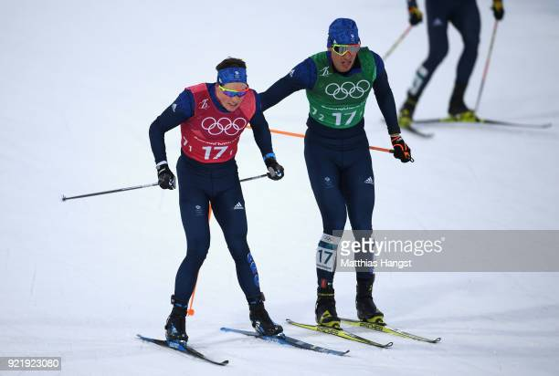 Andrew Musgrave of Great Britain and Andrew Young of Great Britain handover during the Cross Country Men's Team Sprint Free semi final on day 12 of...