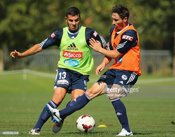 Andrew Nabbout and Mark Milligan compete for the ball during a Melbourne Victory ALeague training session at Gosch's Paddock on February 18 2014 in...
