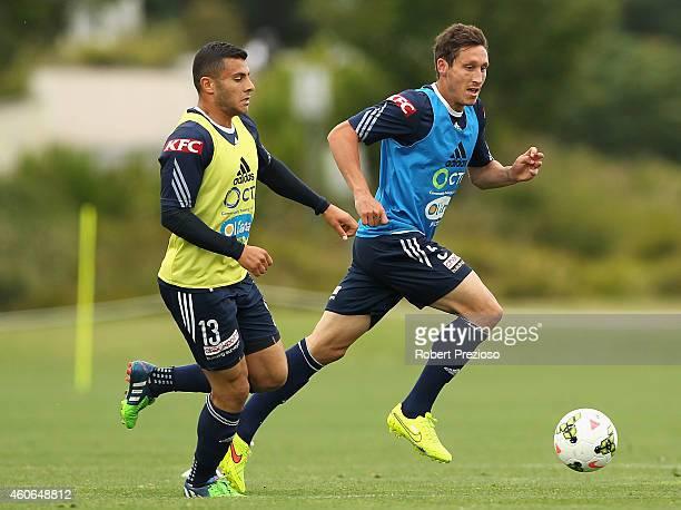 Andrew Nabbout and Mark Milligan contest the ball during a Melbourne Victory ALeague training session at Gosch's Paddock on December 19 2014 in...
