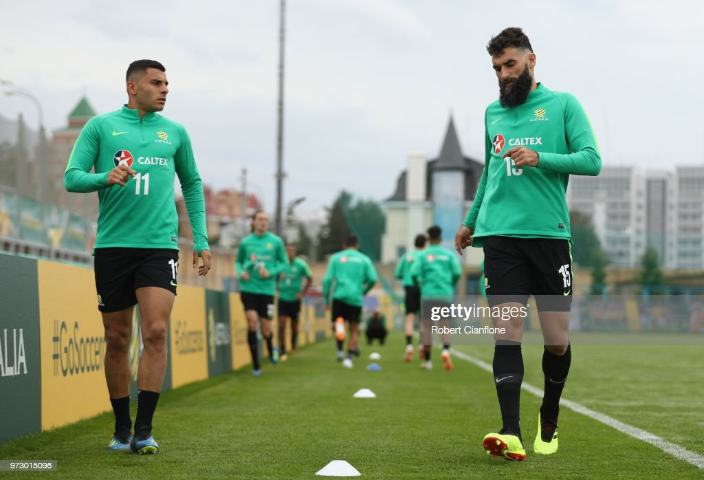 Andrew Nabbout and Mile Jedinak of Australia warm up during an Australia Socceroos training session ahead of the FIFA World Cup 2018at Stadium Trudovye Rezervy on June 13, 2018 in Kazan, Russia.