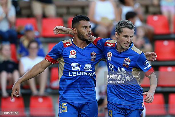 Andrew Nabbout and Morten Nordstrand of the Jets celebrate a goal during the round 12 ALeague match between the Newcastle Jets and the Wellington...