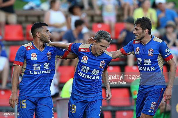 Andrew Nabbout Mateo Poljak and Morten Nordstrand of the Jets celebrate a goal during the round 12 ALeague match between the Newcastle Jets and the...
