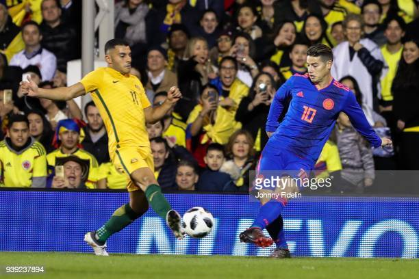 Andrew Nabbout of Australia and James Rodriguez of Colombia during the International friendly match between Colombia and Australia at Craven Cottage...