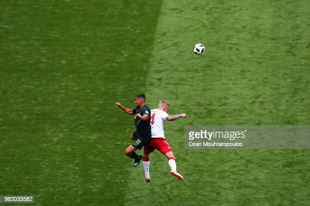 Andrew Nabbout of Australia and Simon Kjaer of Denmark battle for the header ball during the 2018 FIFA World Cup Russia group C match between Denmark...