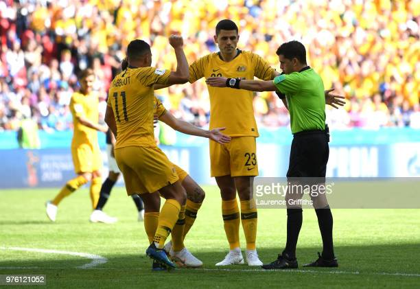 Andrew Nabbout of Australia and Tom Rogic of Australia speak with Referee Andres Cunha during the 2018 FIFA World Cup Russia group C match between...