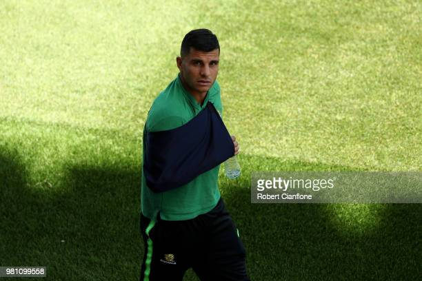 Andrew Nabbout of Australia looks on while wearing a sling after injuring himself in the game against Denmark during an Australian Socceroos training...