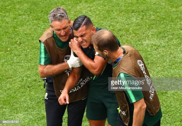 Andrew Nabbout of Australia recieves medical treatment during the 2018 FIFA World Cup Russia group C match between Denmark and Australia at Samara...