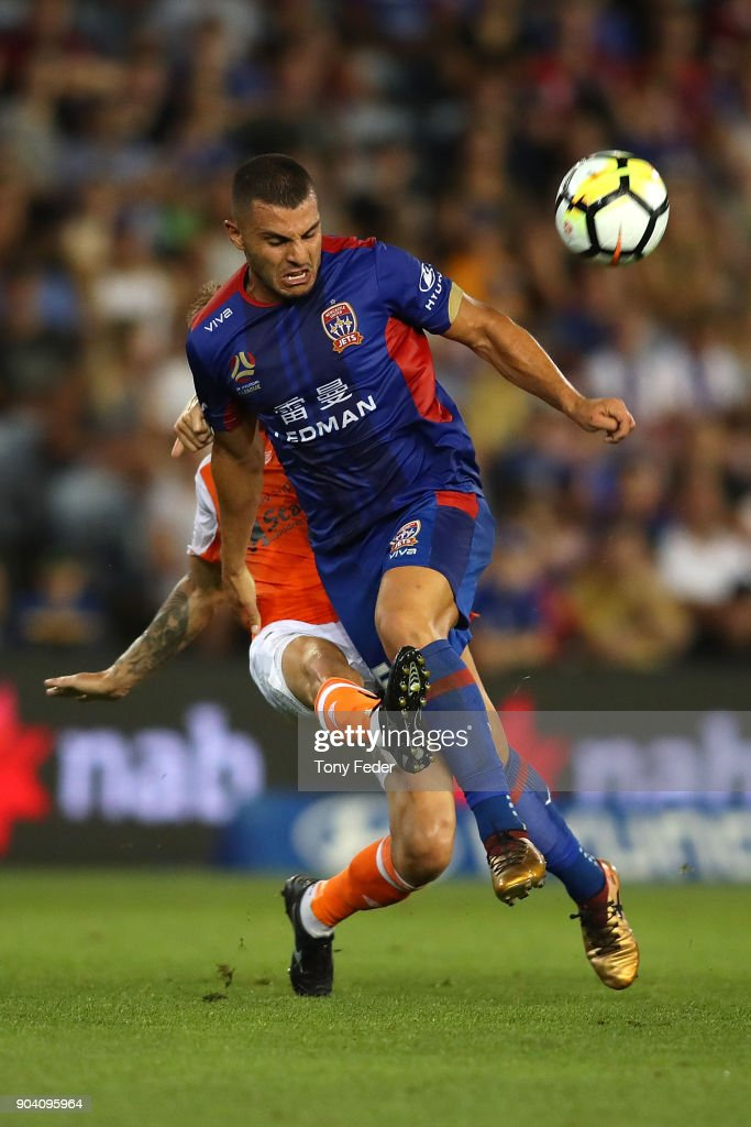 Andrew Nabbout of the Jets and Jacob Pepper of the Roar contest the ball during the round 16 A-League match between the Newcastle Jets and the Brisbane Roar at McDonald Jones Stadium on January 12, 2018 in Newcastle, Australia.