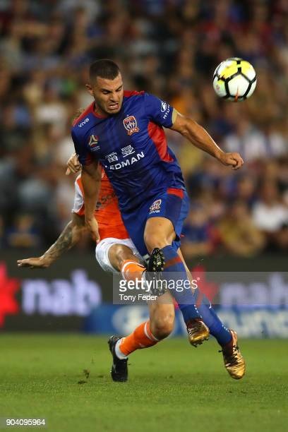 Andrew Nabbout of the Jets and Jacob Pepper of the Roar contest the ball during the round 16 ALeague match between the Newcastle Jets and the...