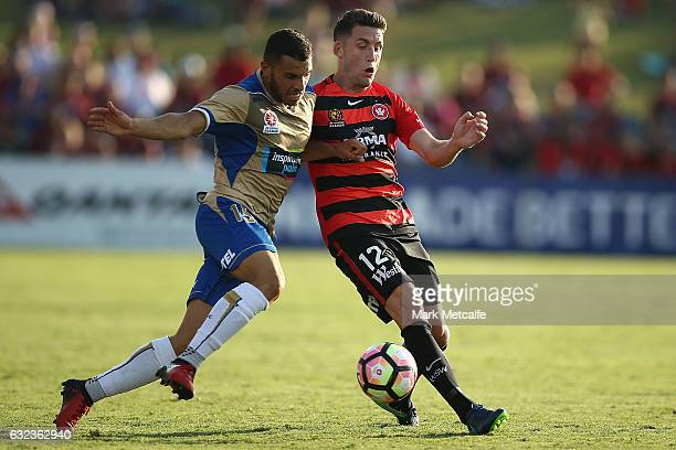 Andrew Nabbout of the Jets and Scott Neville of the Wanderers compete for the ball during the round 16 ALeague match between the Western Sydney...