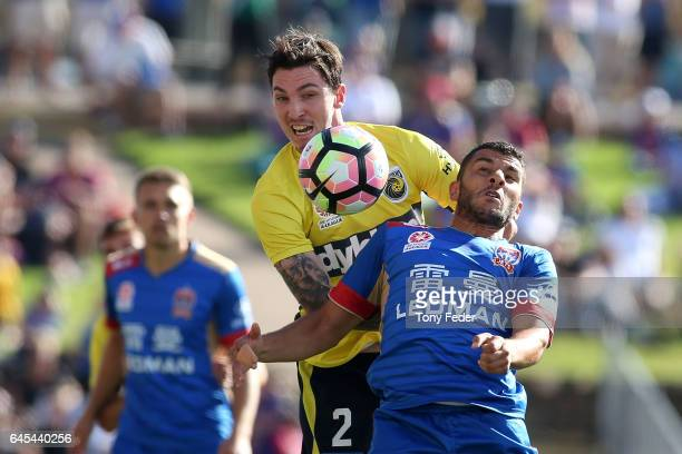 Andrew Nabbout of the Jets and Storm Roux of the Mariners contest the ball during the round 21 ALeague match between the Newcastle Jets and the...