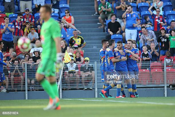 Andrew Nabbout of the Jets celebrates a goal with team mates during the round 12 ALeague match between the Newcastle Jets and the Wellington Phoenix...