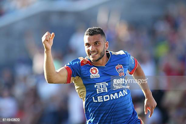 Andrew Nabbout of the Jets celebrates after scoring a goal during the round two ALeague match between the Newcastle Jets and the Brisbane Roar at...