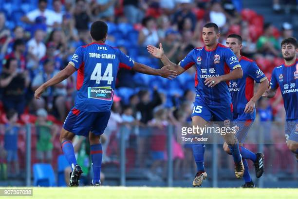 Andrew Nabbout of the Jets celebrates scoring a goal with team mate Nikolai ToporStanley during the round 17 ALeague match between the Newcastle Jets...