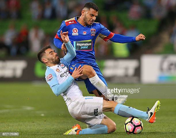 Andrew Nabbout of the Jets collides into Anthony Caceras the City during the round six ALeague match between Melbourne City FC and Newcastle Jets at...