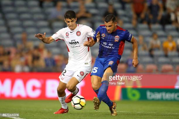 Andrew Nabbout of the Jets contests the ball with Jonathan Aspropotamitis of the Wanderers during the round 12 ALeague match between the Newcastle...