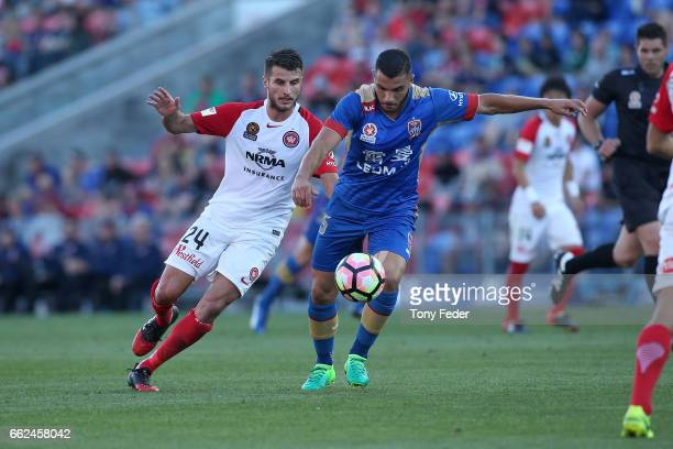 Andrew Nabbout of the Jets contests the ball with Terry Antonis of the Wanderers during the round 25 ALeague match between the Newcastle Jets and the...