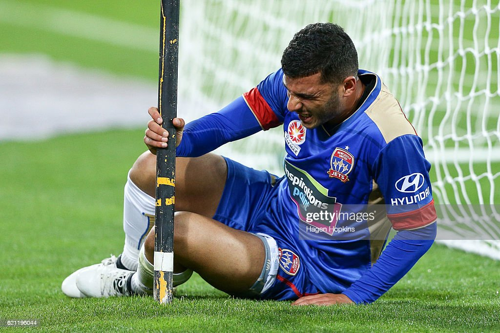 Andrew Nabbout of the Jets grimaces after colliding with a pole during the round five A-League match between the Wellington Phoenix and the Newcastle Jets at Westpac Stadium on November 5, 2016 in Wellington, New Zealand.