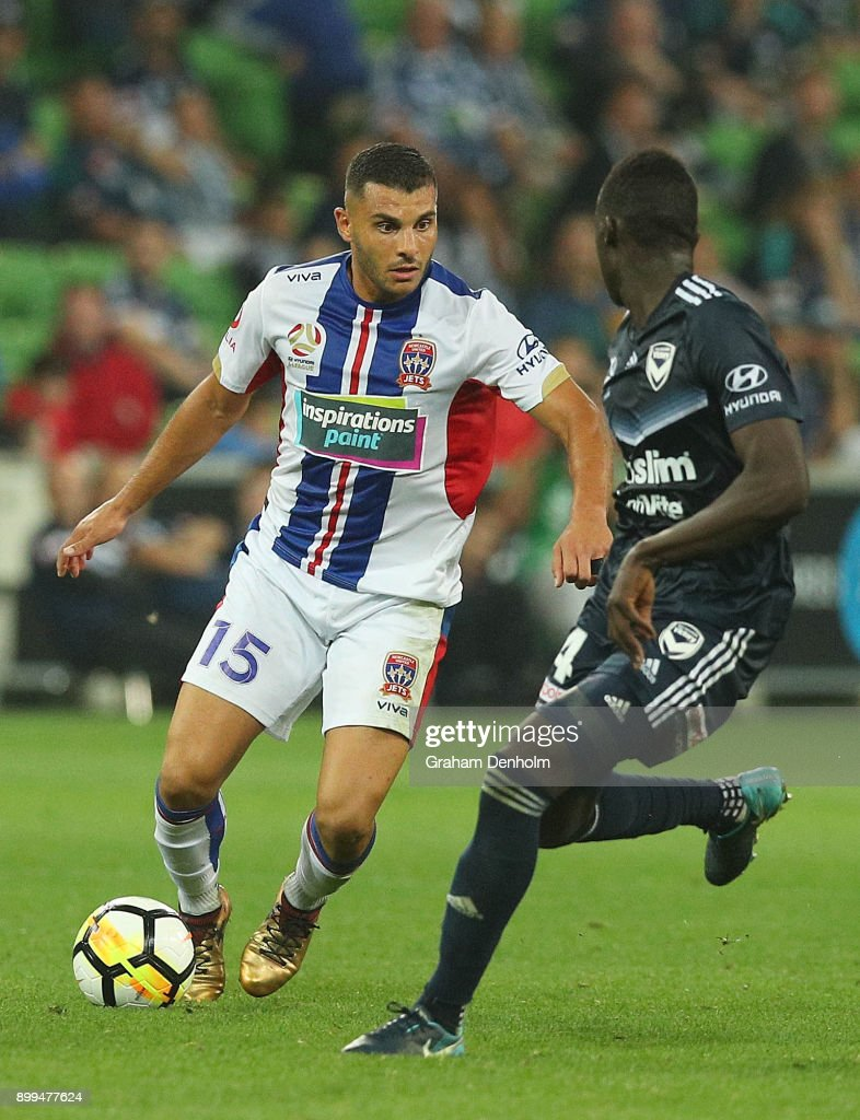 Andrew Nabbout of the Jets (L) in action during the round 13 A-League match between the Melbourne Victory and the Newcastle Jets at AAMI Park on December 29, 2017 in Melbourne, Australia.
