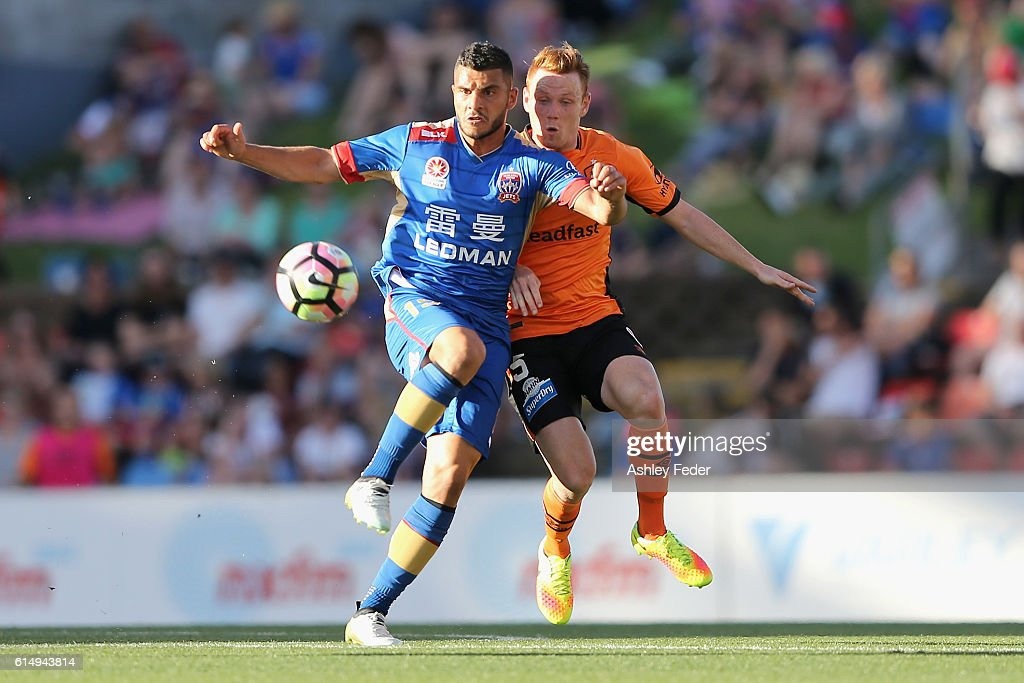 Andrew Nabbout of the Jets is contested by Corey Brown of the Roar during the round two A-League match between the Newcastle Jets and the Brisbane Roar at Hunter Stadium on October 16, 2016 in Newcastle, Australia.