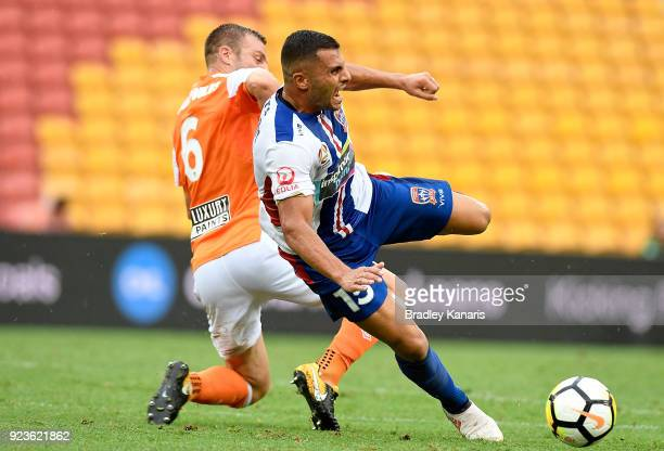 Andrew Nabbout of the Jets is tackled by Avram Papadopoulos of the Roar during the round 21 ALeague match between the Brisbane Roar and the Newcastle...