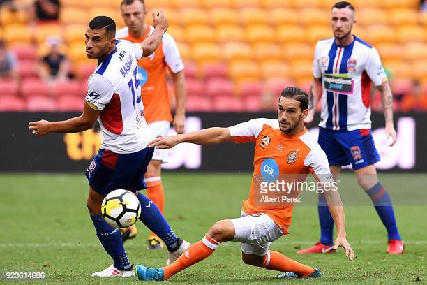 Andrew Nabbout of the Jets is tackled by Jack Hingert of the Roar during the round 21 ALeague match between the Brisbane Roar and Newcastle Jets at...