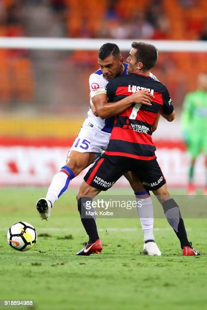 Andrew Nabbout of the Jets is tackled Steven Lustica of the Wanderers during the round 20 ALeague match between the Western Sydney Wanderers and the...