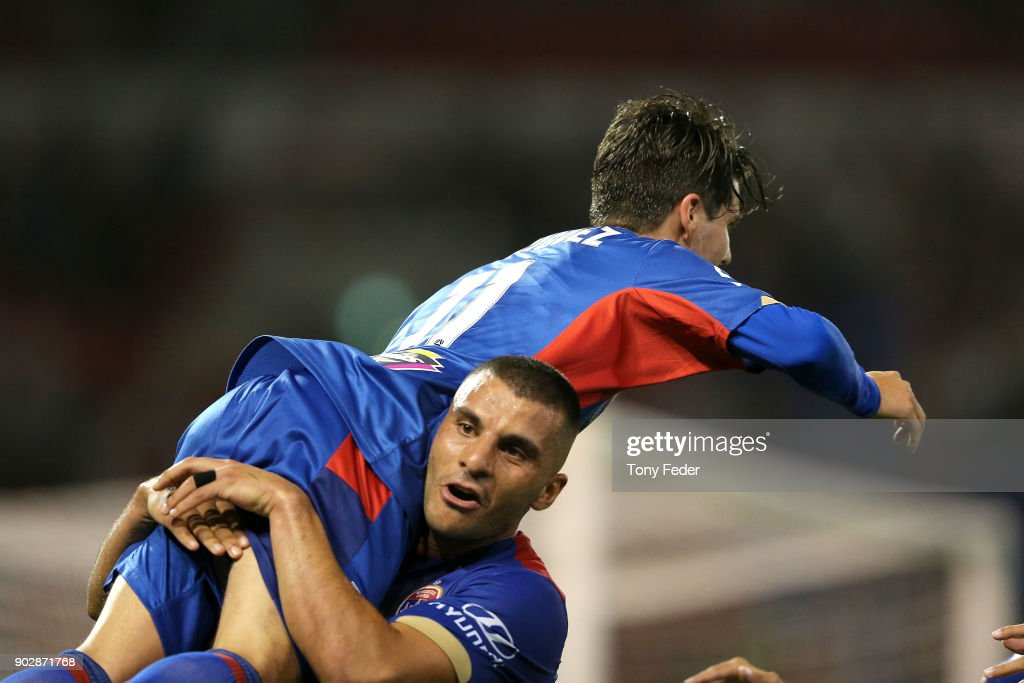 Andrew Nabbout of the Jets picks up team mate Patricio Rodriguez to celebrate a goal during the round 15 A-League match between the Newcastle Jets and the Central Coast Mariners at McDonald Jones Stadium on January 9, 2018 in Newcastle, Australia.