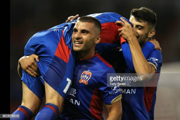 Andrew Nabbout of the Jets picks up team mate Patricio Rodriguez to celebrate a goal during the round 15 ALeague match between the Newcastle Jets and...