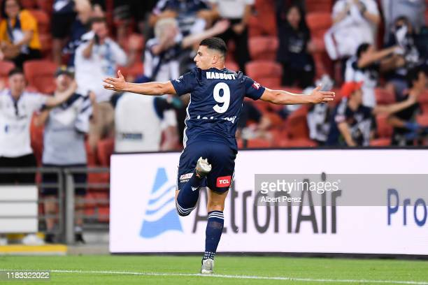 Andrew Nabbout of the Victory celebrates after scoring his team's first goal during the round three ALeague match between the Brisbane Roar and the...