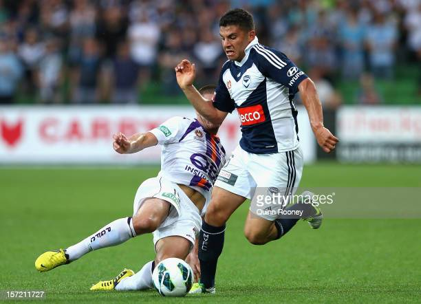 Andrew Nabbout of the Victory is tackled by Joshua Risdon of the Glory during the round nine ALeague match between the Melbourne Victory and the...