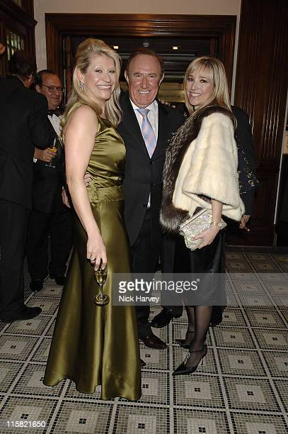 Andrew Neil and guest during Brown's Hotel ReOpening Party December 12 2005 in London Great Britain