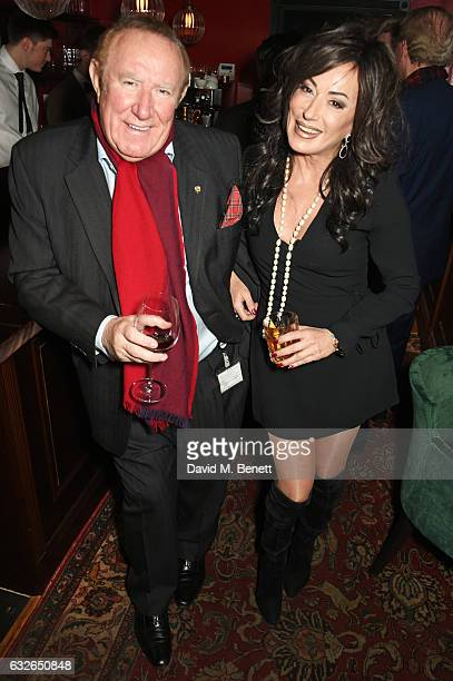 Andrew Neil and Nancy Dell'Olio attend Burns Night at Boisdale Of Mayfair with Macallan on January 24 2017 in London England