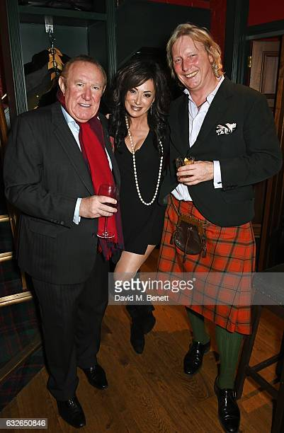 Andrew Neil Nancy Dell'Olio and Ranald Macdonald attend Burns Night at Boisdale Of Mayfair with Macallan on January 24 2017 in London England