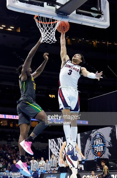 Andrew Nembhard of the Gonzaga Bulldogs goes up for a basket against Jonathan Tchamwa Tchatchoua of the Baylor Bears in the National Championship...