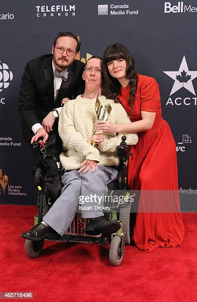 Andrew Nicholas Mccann Smith Ken Harrower and Laura Permutter pose in the press room at the 2015 Canadian Screen Awards at the Four Seasons Centre...