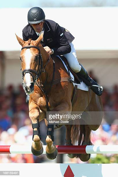 Andrew Nicholson of New Zealand riding Nereo on his way to third place during the showjumping test at Badminton horse trials on May 6 2013 in...