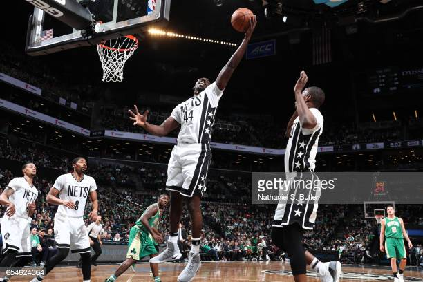 Andrew Nicholson of the Brooklyn Nets grabs the rebound during a game against the Boston Celtics on March 17 2017 at Barclays Center in Brooklyn New...